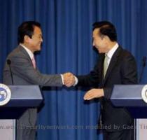 Lee Myungbak and Taro Aso