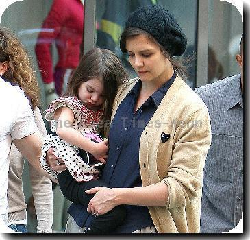 Tom Cruise, Katie Holmes with their daughter Suri leaving the Nike store.