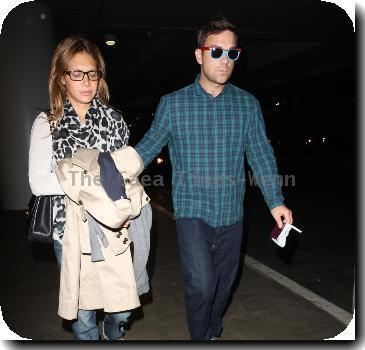 Robbie Williams with his blue suede shoes and blue checked shirt arrives in LA with girlfriend Ayda Field.