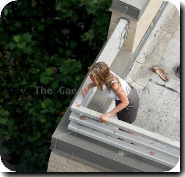 Jennifer Aniston  filming a roof top scene where her character was to jump off the ledge for her new film 'The Bounty'.