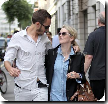 **Exclusive**Edith Bowman and her boyfriend Tom Smithsharing a joke with a friendLondon.