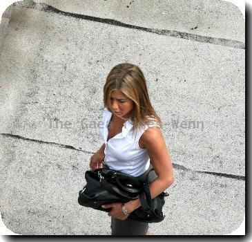 Jennifer Aniston filming a roof top scene