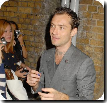 Jude Law signs autographs for waiting fans