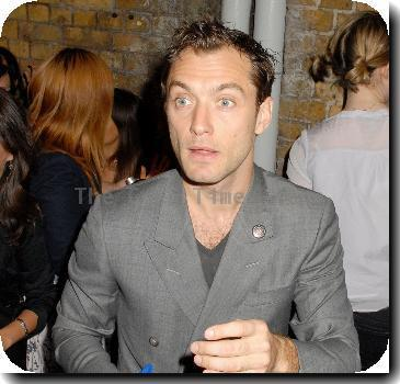 Jude Law signs autographs for waiting fans as he leaves the Wyndham's TheatreLondon.