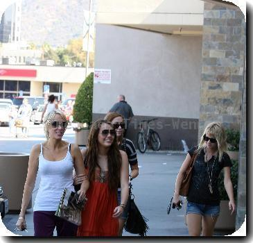 Miley Cyrus spends the day out an about with her friends and family. The star first had lunch with her sister at Sushi Dan, before visiting a hair and tanning salon with their mum in Studio City..