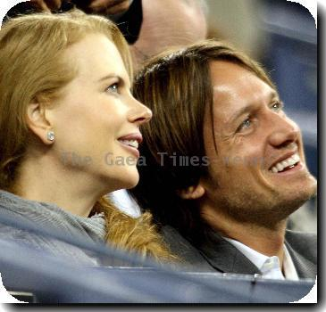 Nicole Kidman and Keith Urban watching  Serena Wiliams of the United States during her match against Flavia Pennetta of Italy on day 9 of the US Open. Wiliams went on to win the match 6-4, 6-3.