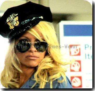 """* ANDERSON AD BANNED Airport bosses have banned a new animal rights commercial featuring PAMELA ANDERSON - because it's too sexy.  Advertising chiefs at People for the Ethical Treatment of Animals (PETA)  filmed a promo in which the former Baywatch beauty stars as a scantily-clad flight security guard who strips passengers of fur and leather.  The ad was due to be shown at New York City's three airports - but bosses pulled the plug over fears the racy film will offend passengers with young children.  New York Post gossip column PageSix reports a representative for CNN Airport Network wrote to PETA bosses to explain the commercial is """"particularly sensitive because children make up part of the demographic in airports"""".  The animal rights group is now hoping to show the film on in-flight entertainment. (ZN/WNWCPS/LR)"""