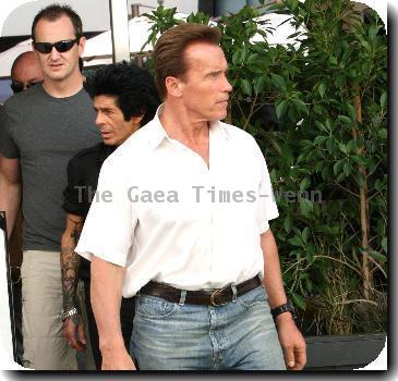 Arnold Schwarzenegger leaving Le Grand Passage restaurant after having lunch with fellow actor Sylvester Stallone..