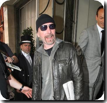 The Edge leaving Claridges hotel in Mayfair..