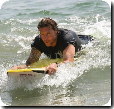 Tori Spelling and Dean McDermott enjoys a day on Malibu Beach with their children.Los Angeles, California.