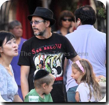 Judd Nelson wearing a t-shirt with 'Iin Love We Trust - See Below - If You Can't Hear Your Mind, Listen To Your Heart. You Will Have The Answer' with his children shopping in Hollywood.