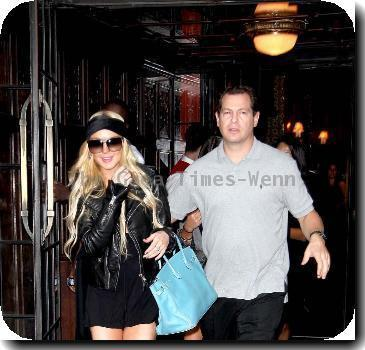 Lindsay Lohan is all smiles shopping in Soho while wearing a black headband New York City.