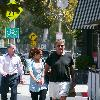 Ryan O'Neal takes food to go after having lunch with a friend.