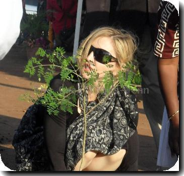 * MADONNA PLANTS TREE TO LAUNCH MALAWI SCHOOL PROJECT MADONNA marked the launch of her girls' school in Malawi by planting a sapling and vowing to provide impoverished locals with the same education opportunities she had growing up. The Material Girl jetted into Malawi - the homeland of her two adopted children David Banda and Mercy James - at the weekend (24-25Oct) to oversee the launch of the school, which is being funded through her Raising Malawi charity. The facility will provide education for 200 local girls who are too poor to afford schooling, and will cost $13.5 million (£9 million) to build. The superstar greeted local officials and construction workers as she laid the first brick. And after planting a young tree to represent the school's beginning, the singer explained her reasons for wanting to finance the project. She said,