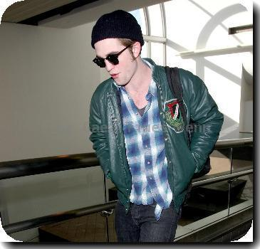 Robert Pattinson arriving at LAX airport while wearing a black winter hat Los Angeles.