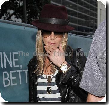 Jennifer Aniston arriving at LAX airport sporting ripped jeans, striped tops, and leather jacketLos Angeles.
