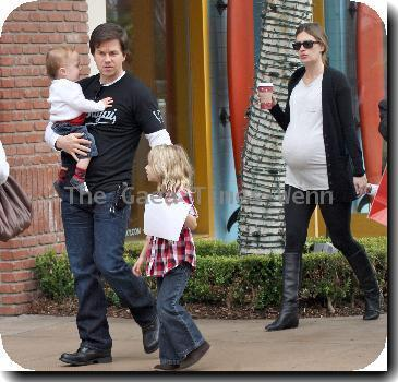 **Exclusive** Actor/Producer Mark Wahlberg with his pregnant wife Rhea Durham out doing christmas shopping and visiting Santa's house with their children.