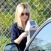 Reese Witherspoon feeds the parking meter while running errands in Beverly Hills.