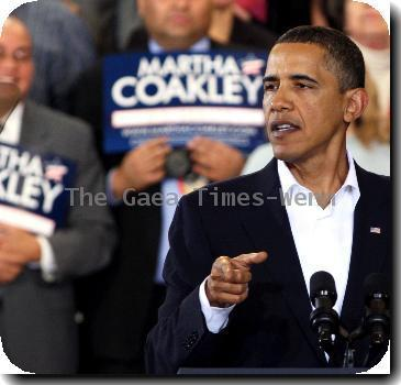 U.S. President Barack Obama joins Martha Coakley, the attorney general of Massachusetts and Democratic candidate for the U.S. Senate, during a campaign rally.