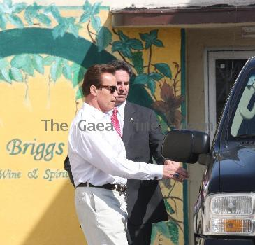 Arnold Schwarzenegger returns to his vehicle after a spot of lunch in Brentwood, CA Los Angeles.