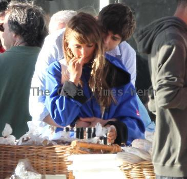 Ashton Kutcher snuggles up at a market stall to an actress on the set of an untitled film project by Ivan Reitman at a farmer's market.Los Angeles.