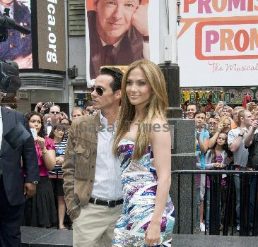 Jennifer Lopez and Marc Anthony attend the unveiling of 'Be Extraordinary' billboard in Times Square New York City.