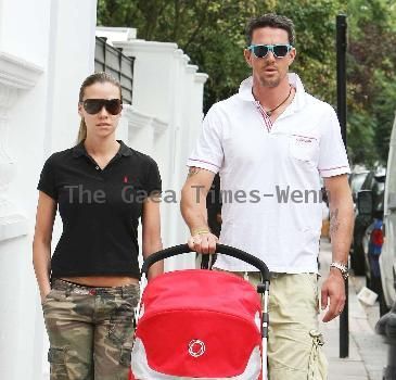 Kevin Pietersen and Jessica Taylor taking a stroll in Chelsea with their son Dylan London, England.