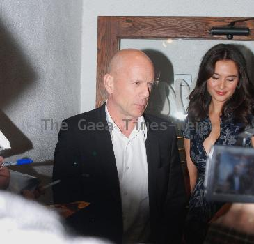 Bruce Willis with girlfriend Emma Heming  Celebrities leaving Madeos restaurant in West Hollywood.  Los Angeles, California.