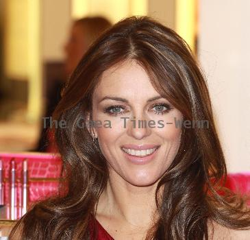 Elizabeth Hurley aka signs the Est�e Lauder Pink Ribbon Collection of products, to raise money for Breast Cancer Awareness at Harrods London, England.