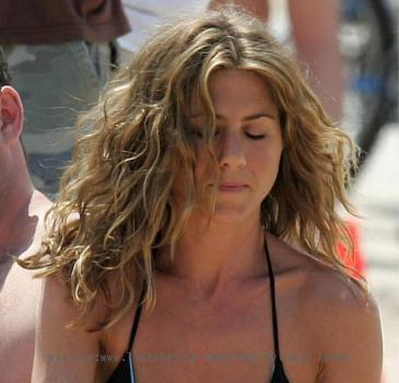 Jennifer Aniston appears almost naked on beach for perfume ad
