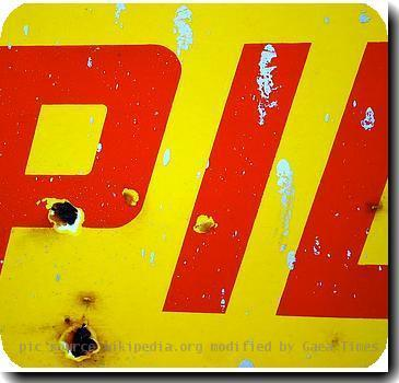 : Photograph of sign featuring one of the PIL logos designed by Dennis Morris for John Lydon and his band Public Image Ltd.  Source: Flickr