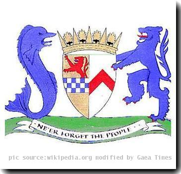 Coat of arms of South Ayrshire Council, granted by Lord Lyon King of Arms December 9, 1996. The arms and a different motto were previously granted to Kyle and Carrick District Council in 1975, the supporters were added in the