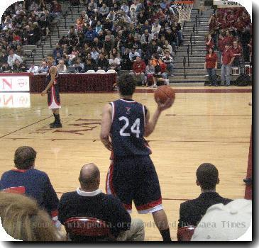University of Pennsylvania senior Mark Zoller inbounds the ball to senior Ibby Jaaber during the first half of Penns game with Harvard at the Lavietes Pavilion in Boston, Massachusetts on February 23, 2007. The Quakers defeated the Crimson, 83-67.