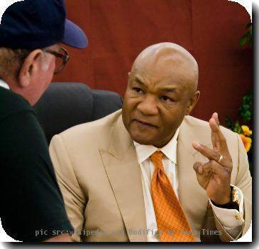 George Foreman lists his three heroes for an adoring fan and fellow Wal-Mart shopper