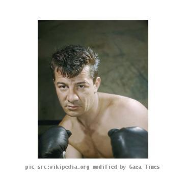 This is a colored historic image of a great boxer.