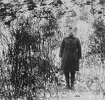 Above    Sergeant Alvin C  York  328th Infantry  poses at the hill in the Argonne Forest on which his famous raid raid took place during World War I in which he captured 132 German prisoners